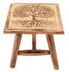 A beautiful natural wooden stool featuring a gorgeous Tree of Life carved decal