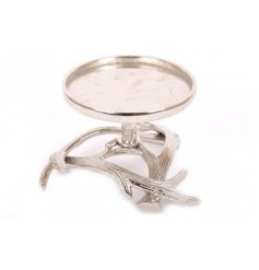 A chic and stylish silver toned candle holder with an Antler inspired base design