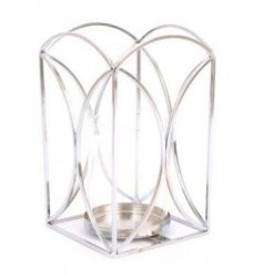 A large sized silver wired candle lantern sure to place perfectly in any home