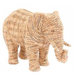 A natural woven wicker inspired ornamental elephant, sure to place perfectly in any home