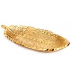 A sleek and stylish golden toned feather trinket dish,