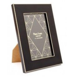 A statement looking black picture frame set with a sleek gold trimming