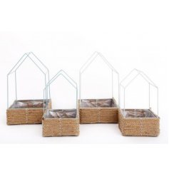 An assortment of sage green and white toned wire house shaped planters