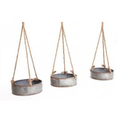 An assorted sized set of hanging metal planters, sure to place perfectly in any garden space