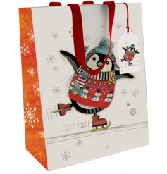 A festive themed gift bag decorated with an adorable whimsical penguin print