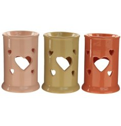A gorgeous mix of ceramic oil burners with heart cut details and charming colours