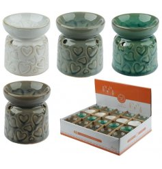 A charming mix of ceramic oil burners each set with an earthen colour tone and embossed heart design