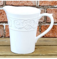 a white toned ceramic jug with a spiral heart decal