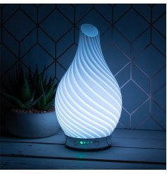 Decorated with a gorgeous blue wave design, this Humidifier also features a calming colour changing LED fitting inside