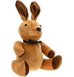 A charming little Brown toned velveteen rabbit doorstop with high pointed ears and a tied ribbon