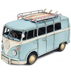 an ornamental metal Volkswagen in a light blue tone