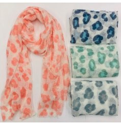 An assortment of soft fabric scarves with added colourful leopard prints on each