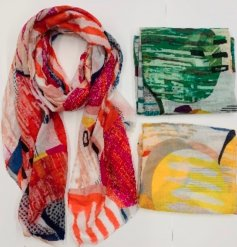 An assortment of 3 bold and colourful patterned scarves