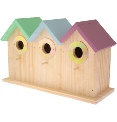 A large and colourful wall mounted bird feeder with 3 port holes