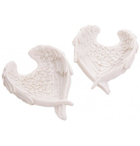 An Angel Wing Shaped Trinket Dish with added detailed touches and a white tone