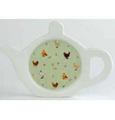 A chicken print porcelain teabag tidy with a green back tone