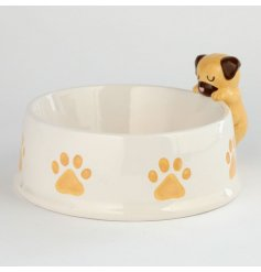 Perfect for any four pawed friend and their meals, a round white pet bowl with an added Pug Decal on the rim