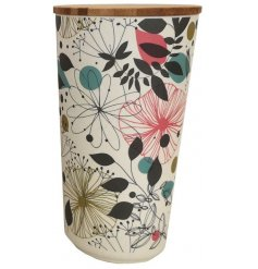 Perfect for storage in any home of the house, a large bamboo based pot with a pretty botanical print across it