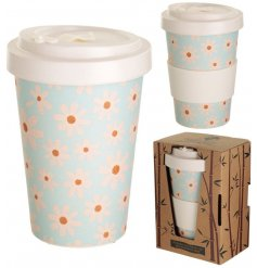 A pretty blue toned travel mug with a delicate white daisy decal