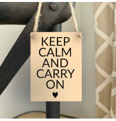A chic mini metal sign with a popular positivity slogan reading Keep Calm and Carry On.