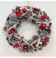 A large decorative wooden wreath with added bold red accents to it
