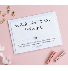 Say it with a wish bracelet. A lovely bracelet with star charm set on a slogan card