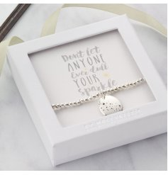 Don't let anyone ever dull your sparkle. A beautiful sentiment gift bracelet with a charm decorated with cascading stars