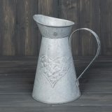 A rustic zinc jug with a pretty embossed heart design.