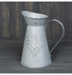 A charming zinc jug with an embossed heart design in the middle. Perfect for display