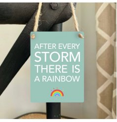 After every storm there is a rainbow. A colourful mini metal sign with a positive sentiment slogan.