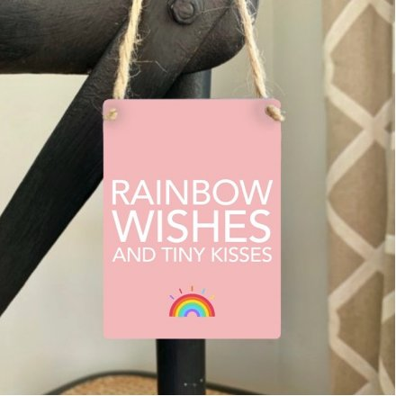 Rainbow Wishes and Tiny Kisses. A mini metal sign with a charming sentiment slogan