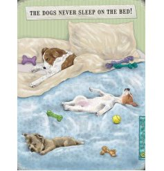 An adorable and humorous metal sign featuring dogs sleeping on the bed! A fantastic gift item for dog lovers.
