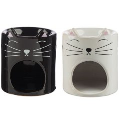 A mix of black and white cat themed ceramic oil burners