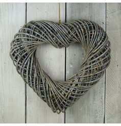 A bold and beautiful woven wicker heart hanging decoration set with a distressed charm