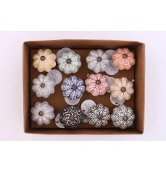 A mixed box of flower shaped drawer knobs, each with a pretty decorative pattern.