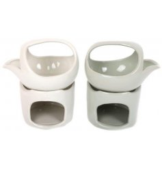 A mix of 2 contemporary oil burners in white and sage colours. A chic accessory for the home.