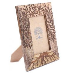 A rustic wooden photo frame with a charming tree of life engraved image.