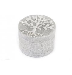 An attractive silver trinket box with a tree of life symbol.