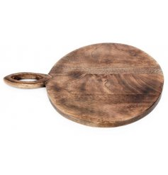 A natural wooden chopping board with carved handle.