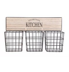 A rustic living kitchen sign with 3 black metal storage baskets.