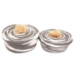 A set of 2 super stylish grey and white swirl baskets, each with a natural pom pom top.