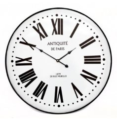 A large metal clock with roman numerals. Complete with a vintage Parisian slogan.