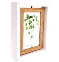 An attractive white wooden frame with a natural wood rotating photo holder in the centre.