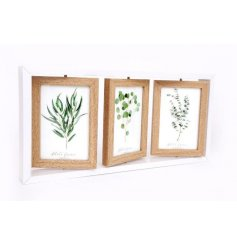 A stylish white wooden frame with three hanging photo frames, each with a natural finish.
