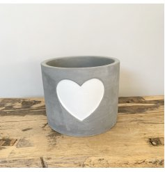 A rough luxe cement planter with a white painted heart. A chic interior accessory for the home.