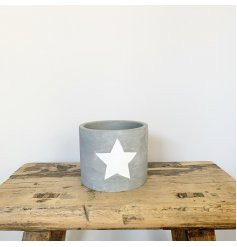 A rough luxe cement planter with a white painted star. A chic interior accessory for the home.