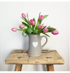 A classic, super stylish grey jug with a white heart design.