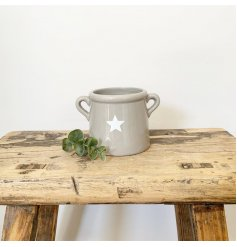 An effortlessly cool and stylish small ceramic pot with handles and a star design.