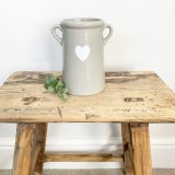 A chic medium sized pot with twin ears. Complete with a pretty white heart decoration.