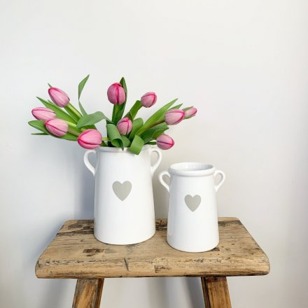 A chic ceramic pot with twin ears and a pretty grey heart detail.